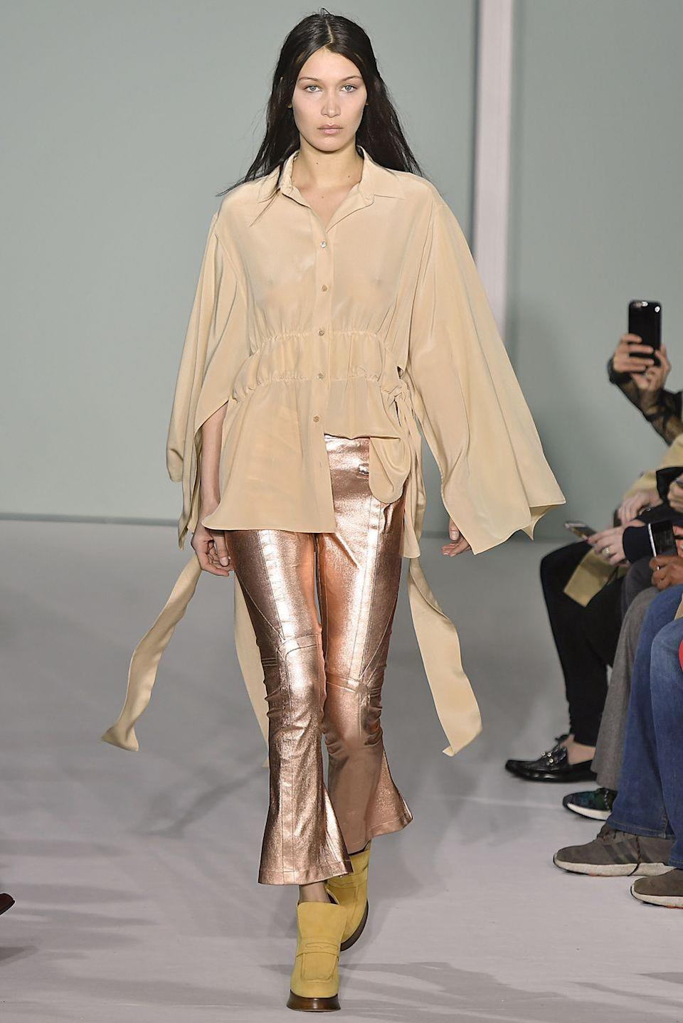 <p>Bella wore rose-gold trousers and a cream shirt for Sies Marjan AW17's runway collection at NYFW</p>