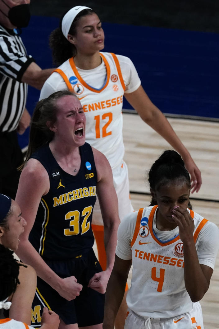 Michigan guard Leigha Brown (32) celebrates after making a basket during the first half of a college basketball game against Tennessee in the second round of the women's NCAA tournament at the Alamodome in San Antonio, Tuesday, March 23, 2021. (AP Photo/Charlie Riedel)