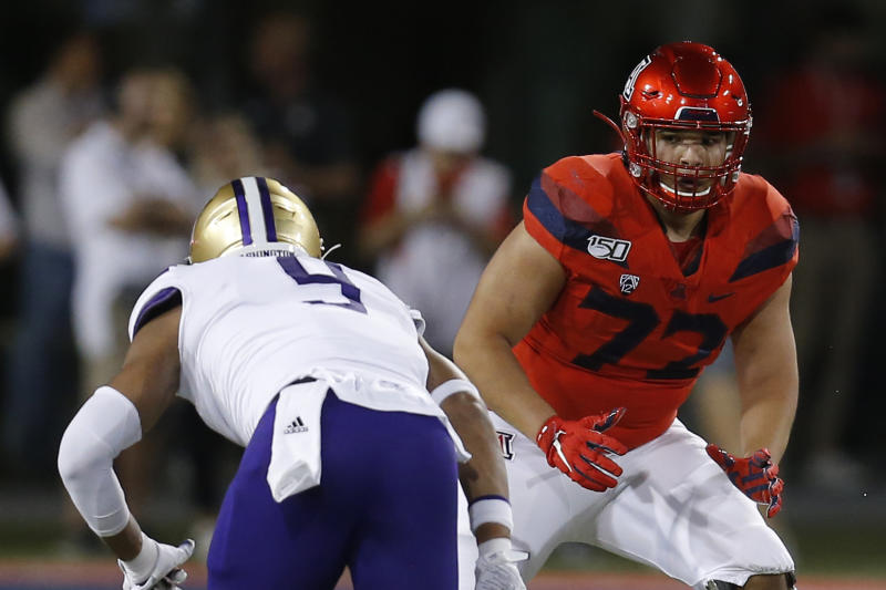 Arizona offensive lineman Edgar Burrola (72) in the first half during an NCAA college football game against Washington, Saturday, Oct. 12, 2019, in Tucson, Ariz. (AP Photo/Rick Scuteri)