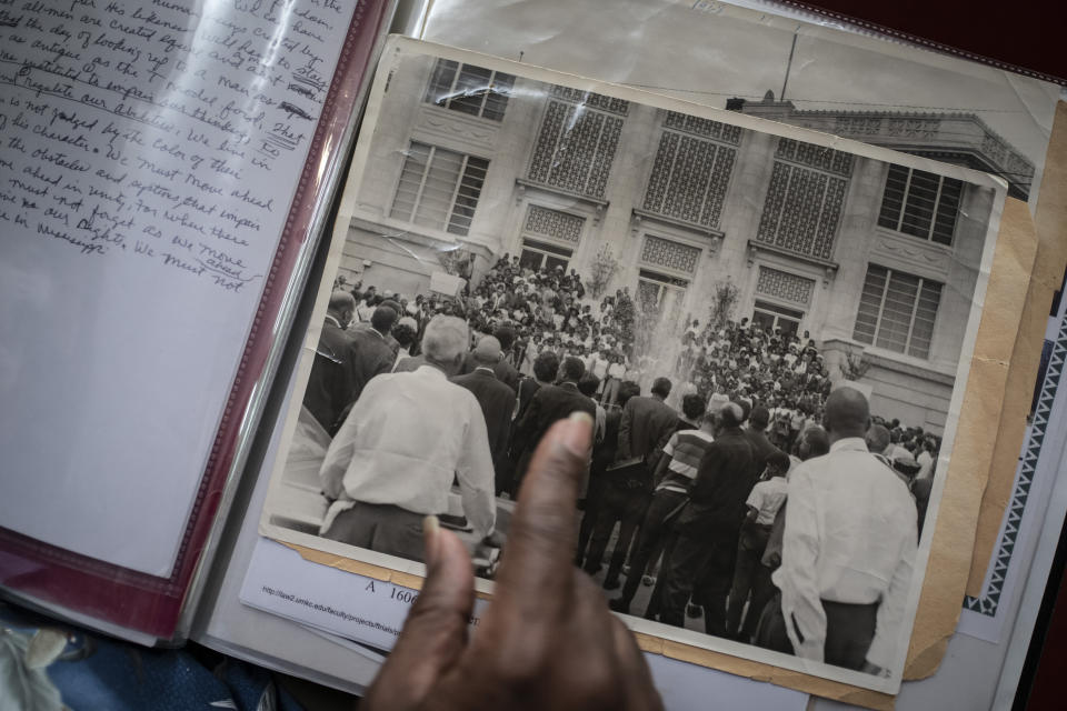 "Rev. Charles Johnson, 82, points to an old photo of a gathering after the death of Rev. Martin Luther King Jr., during an interview with The Associated Press, in Meridian, Miss., Monday, Oct. 5, 2020. The old civil rights worker worries that Mississippi is drifting into its past. ""I would never have thought we'd be where we're at now, with Blacks still fighting for the vote,"" said Johnson. (AP Photo/Wong Maye-E)"