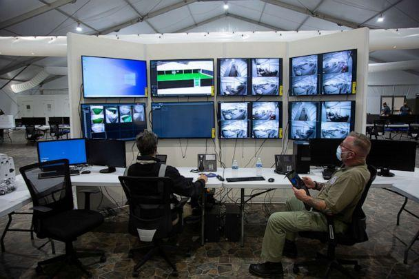 PHOTO: Agents watch monitoring screens as temporary U.S. Customs and Border Protection processing facilities are constructed in anticipation of a surge in migration in Donna, Texas, Feb. 8, 2021. (U.S. Border Patrol via Reuters)