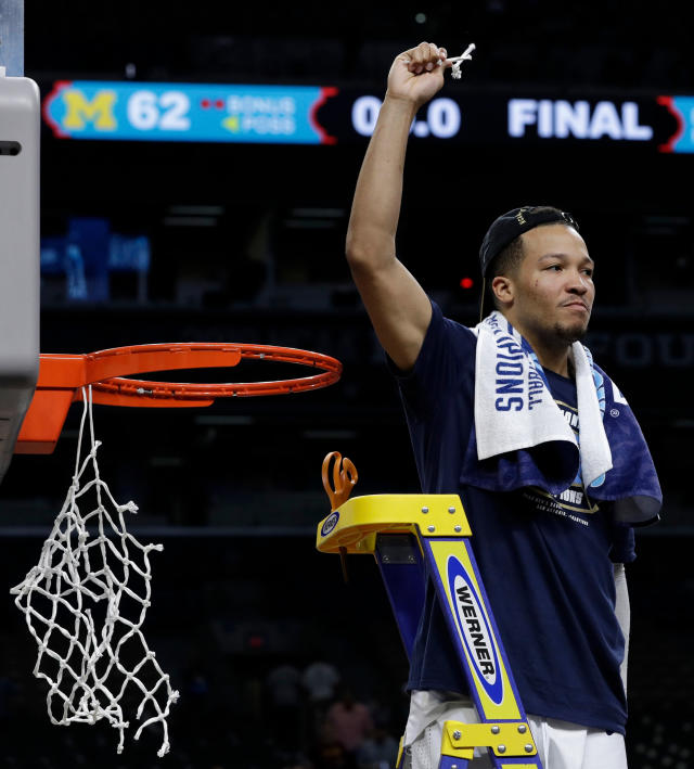 Villanova's Jalen Brunson cuts the net as he celebrates after the championship game of the Final Four NCAA college basketball tournament against Michigan, Monday, April 2, 2018, in San Antonio. Villanova won 79-62. (AP Photo/David J. Phillip)