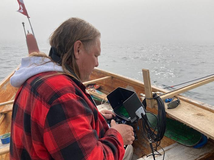 Little Traverse Bay Bands of Odawa Indians tribal council member Fred Harrington Jr. observes images from a remote-operated underwater vehicle along the Straits of Mackinac lake bottom near the Line 5 oil pipeline in this Sept. 23, 2020 photo.