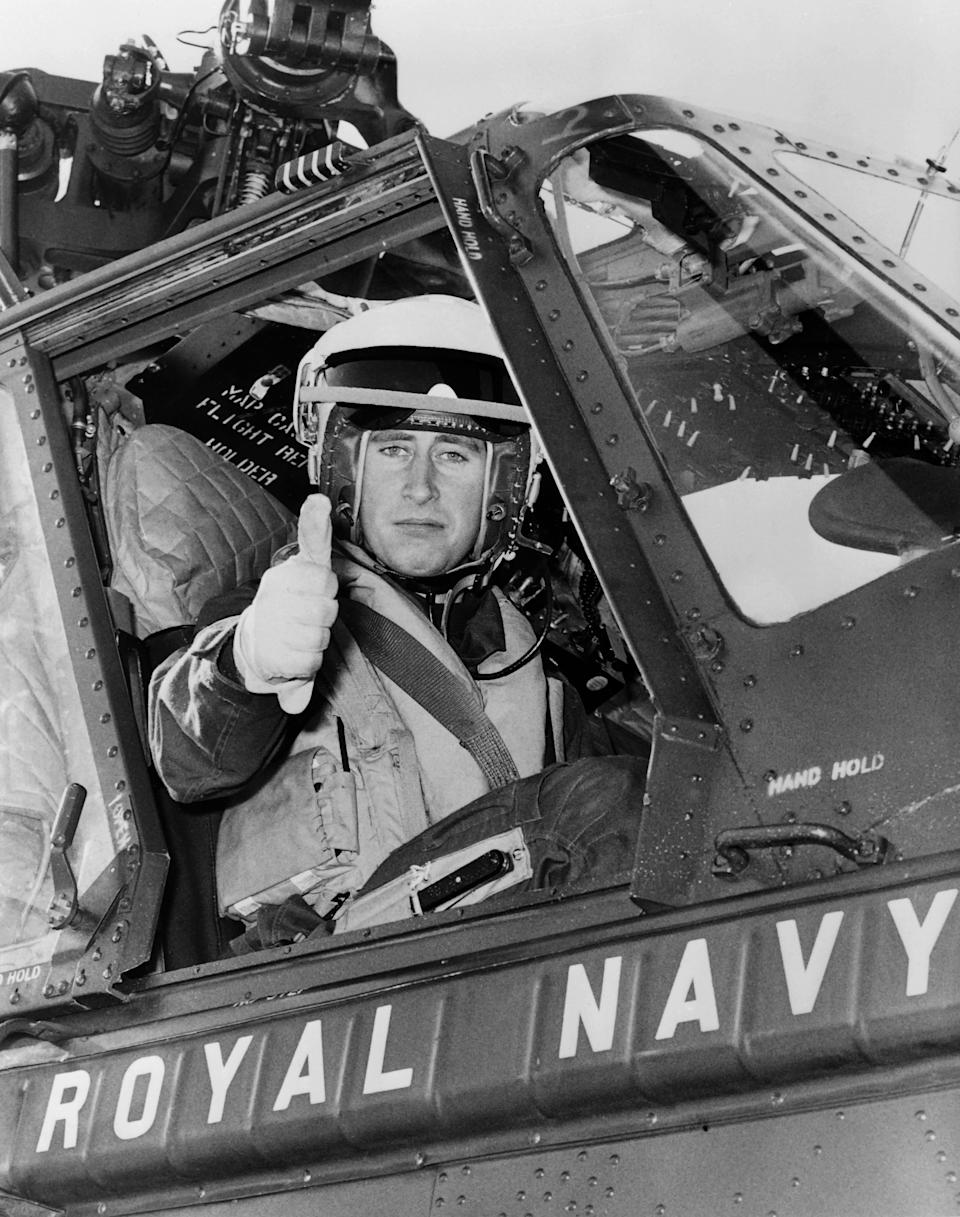 Picture taken on October 10, 1972 showing Prince Charles of Wales on board a Royal Navy's helicopter. (Photo by - / CENTRAL PRESS PHOTO LTD / AFP)        (Photo credit should read -/AFP via Getty Images)