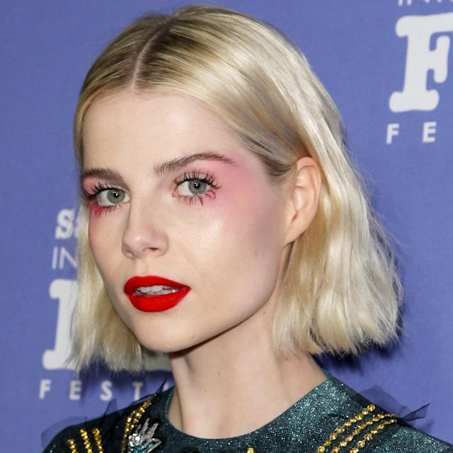 "Although we're never surprised when <a href=""https://www.allure.com/story/lucy-boynton-red-carpet-beauty?mbid=synd_yahoo_rss"" rel=""nofollow noopener"" target=""_blank"" data-ylk=""slk:Lucy Boynton's makeup"" class=""link rapid-noclick-resp"">Lucy Boynton's makeup</a> is a work of creative genius, we're still floored every time it happens. At the Santa Barbara International Film Festival event, Jo Baker used <a href=""https://www.glossier.com/products/cloud-paint"" rel=""nofollow noopener"" target=""_blank"" data-ylk=""slk:Glossier Cloud Paint"" class=""link rapid-noclick-resp"">Glossier Cloud Paint</a> in Puff to create a pink aura complemented by the glow from pink <a href=""https://shop-links.co/1663386068536842425"" rel=""nofollow noopener"" target=""_blank"" data-ylk=""slk:Dior Pump'N'Volume Mascara"" class=""link rapid-noclick-resp"">Dior Pump'N'Volume Mascara</a> on Boynton's lower lashes. A matte red lip takes the look from ethereal to downright incredible."