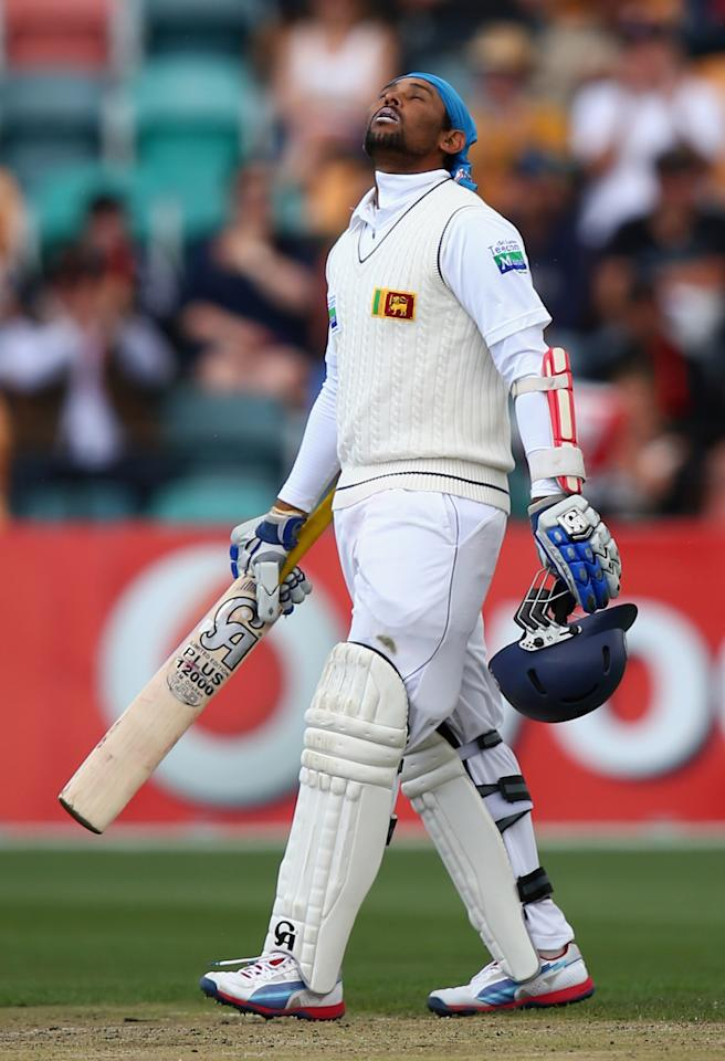 HOBART, AUSTRALIA - DECEMBER 16:  Tillakaratne Dilshan of Sri Lanka celebrates after reaching his century during day three of the First Test match between Australia and Sri Lanka at Blundstone Arena on December 16, 2012 in Hobart, Australia.  (Photo by Ryan Pierse/Getty Images)