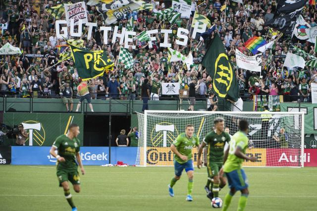 "Fans waved flags, including the Iron Front symbol, during a match between the <a class=""link rapid-noclick-resp"" href=""/soccer/teams/portland-timbers/"" data-ylk=""slk:Timbers"">Timbers</a> and Sounders on Friday. (Reuters)"