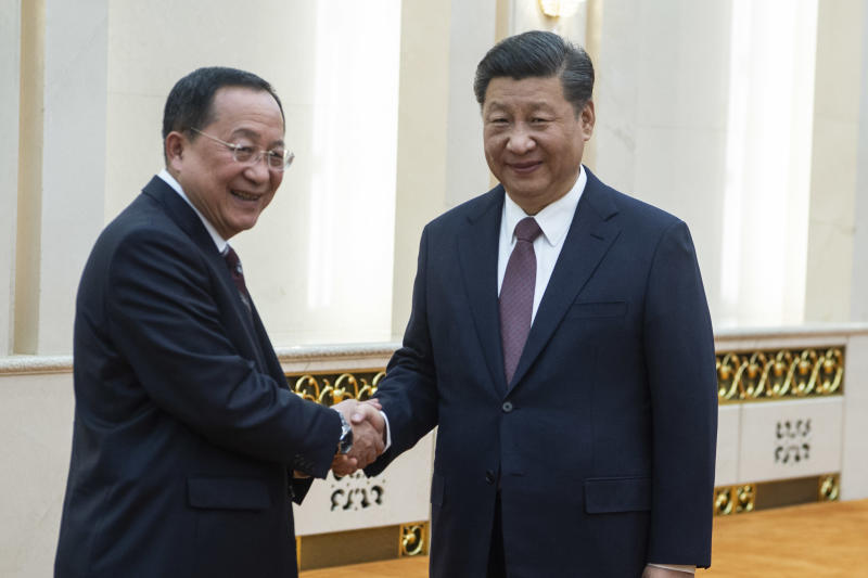 China's President Xi Jinping, right, shakes hands with North Korean Foreign Minister Ri Yong Ho at the Great Hall of the People in Beijing, Friday, Dec. 7, 2018. The foreign ministers of China and North Korea held talks in Beijing Friday amid a lack of progress in international efforts to persuade Kim Jong Un's regime to halt its nuclear weapons program.(Fred Dufour/Pool Photo via AP)
