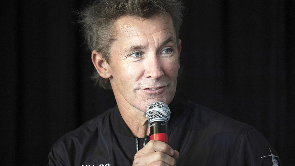 Troy Bayliss, pictured here speaking to the media during a press conference.