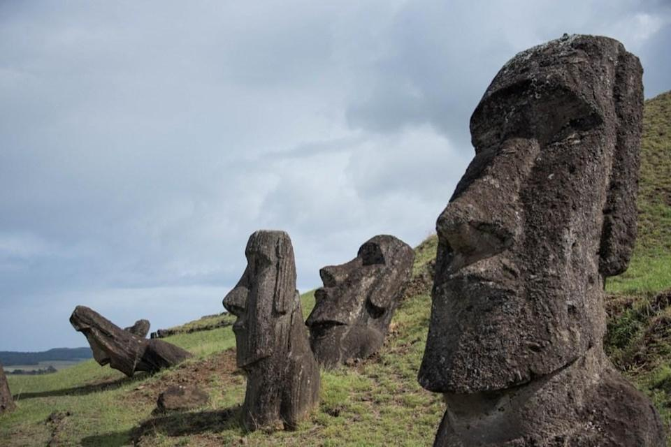 """You know the heads of the Easter Island figures, but often overlooked is the fact that they also have bodies. Archaeologists at the University of California, Los Angeles have developed the Easter Island Statue Project to dig deeper into these Pacific Island icons and explore what's below the surface. The answer? <a href=""""https://www.forbes.com/sites/trevornace/2017/07/26/famous-easter-island-heads-have-hidden-bodies/#4d58dd8ff804"""" rel=""""nofollow noopener"""" target=""""_blank"""" data-ylk=""""slk:Full-bodies statues"""" class=""""link rapid-noclick-resp"""">Full-bodies statues</a> measuring as much as 33 feet high."""