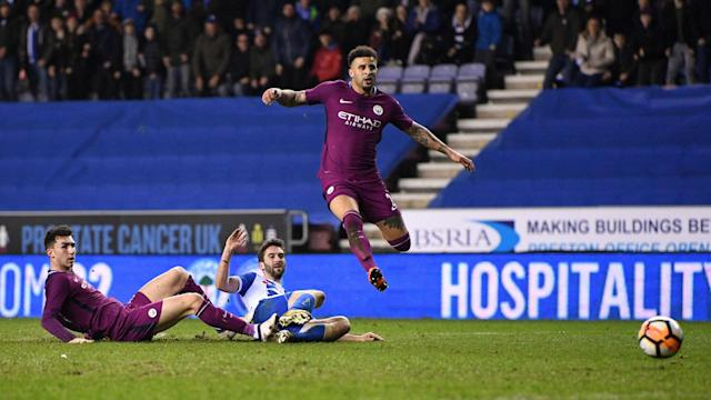 Manchester City had Fabian Delph sent off and crashed to a shock FA Cup fifth-round defeat, with Will Grigg League One Wigan's hero.