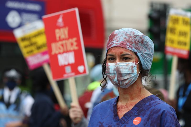 An NHS worker at St Thomas' Hospital, London, attending a rally to demand the government give them a 15 per cent pay rise.