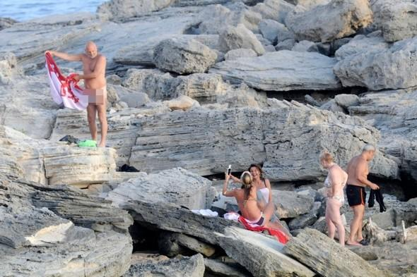 Fun in the sun! Kate Moss snaps pic of naked tourist in Ibiza