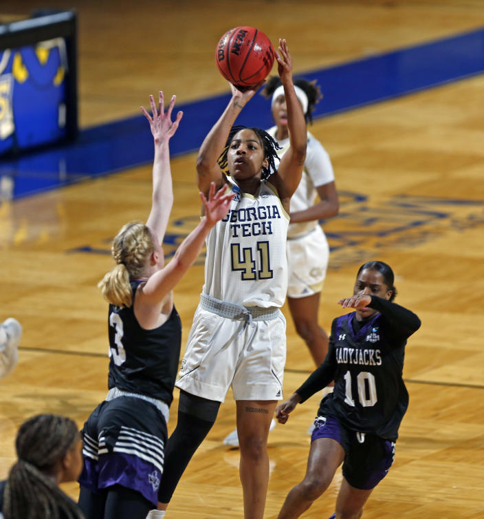 Georgia Tech guard Kierra Hermosa(41) scores over Stephen F. Austin guard Stephanie Visscher(13) during the first half of a college basketball game in the first round of the women's NCAA tournament at the Greehey Arena in San Antonio, Texas, Sunday, March 21, 2021. (AP Photo/Ronald Cortes)