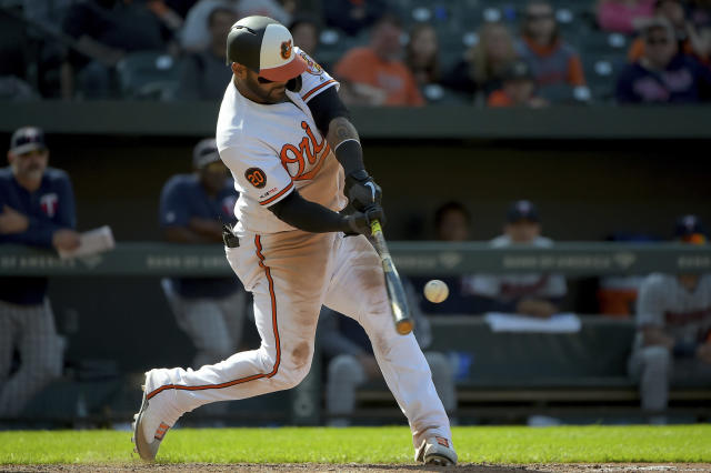 Baltimore Orioles Jonathan Villar connects for an RBI double to score Joey Rickard (23) in the ninth inning of a baseball game against the Minnesota Twins, Sunday, April 21, 2019, in Baltimore. (AP Photo/Will Newton)