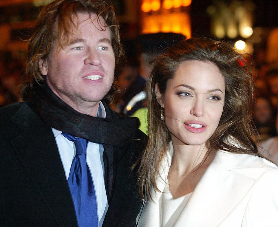 """DUBLIN - JANUARY 6:  Angelina Jolie and Val Kilmer arrive at the Irish Premiere of """"Alexander"""" at the Savoy Cinema on January 6, 2005 in Dublin, Ireland.  (Photo by Julien Behal/Getty Images)"""