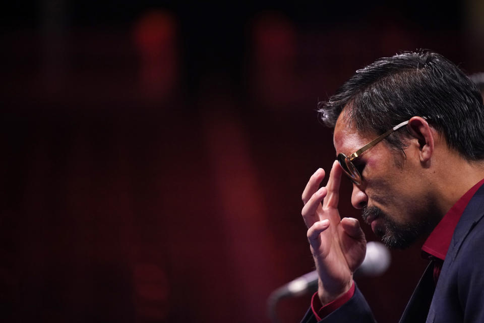 Manny Pacquiao, of the Philippines, listens at a news conference after his loss to Yordenis Ugas, of Cuba, in a welterweight championship boxing match Saturday, Aug. 21, 2021, in Las Vegas. (AP Photo/John Locher)