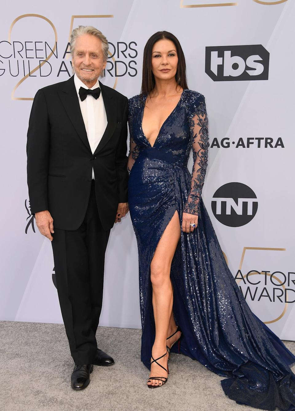 <p>Michael Douglas and Catherine Zeta Jones, in a Zuhair Murad gown, on the carpet at the 2019 Screen Actors Guild Awards together in Los Angeles. (Photo: Getty Images) </p>