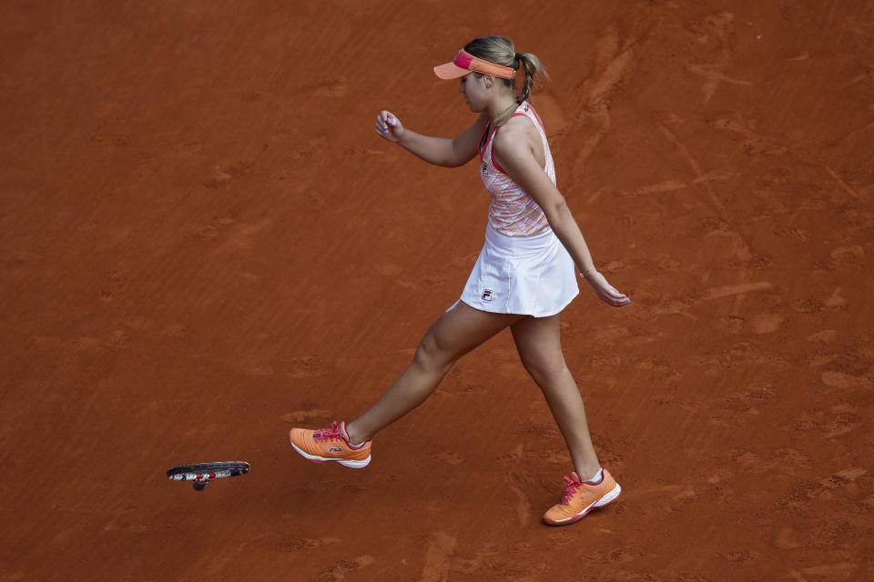 Sofia Kenin of the U.S. kicks her racket after missing a shot against Poland's Iga Swiatek in the final match of the French Open tennis tournament at the Roland Garros stadium in Paris, France, Saturday, Oct. 10, 2020. (AP Photo/Alessandra Tarantino)