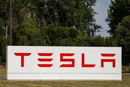A sign is seen outside the Tesla Inc. Gigafactory 2, which is also known as RiverBend, a joint venture with Panasonic to produce solar panels and roof tiles in Buffalo, New York