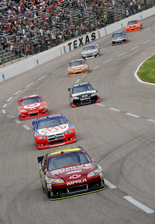 FORT WORTH, TX - NOVEMBER 06: Jeff Gordon, driver of the #24 Drive to End Hunger Chevrolet, leads a pack of cars during the NASCAR Sprint Cup Series AAA Texas 500 at Texas Motor Speedway on November 6, 2011 in Fort Worth, Texas. (Photo by Jared C. Tilton/Getty Images for NASCAR)