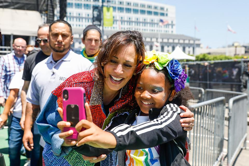 Senator Kamala Harris takes a selfie with a young girl after participating in the annual Pride Parade in San Francisco, California, on Sunday, June 30, 2019. (Gabrielle Lurie/The San Francisco Chronicle via Getty Images)