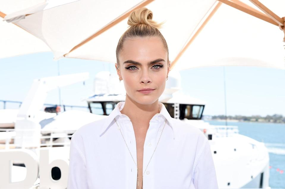"""<p>For a hot day at Comic-Con, <a href=""""https://www.popsugar.com/beauty/Cara-Delevingnes-Denim-Eyeliner-Topknot-Comic-Con-2019-46408036"""" class=""""link rapid-noclick-resp"""" rel=""""nofollow noopener"""" target=""""_blank"""" data-ylk=""""slk:Delevingne wore her bright blond hair in a fun twisted top knot"""">Delevingne wore her bright blond hair in a fun twisted top knot</a>. But that wasn't the only hair surprise. At the back of her head, the hair was sectioned into a low bun that was then twisted into itself.</p>"""