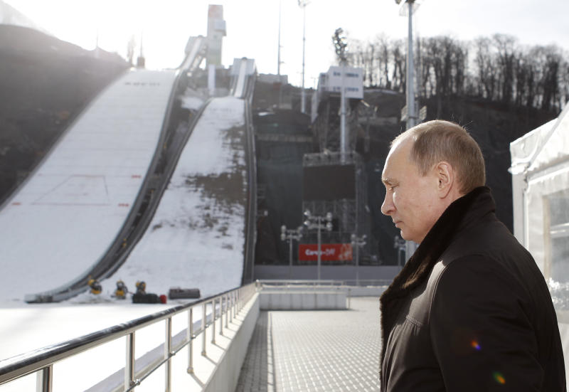 Russian President Vladimir Putin visits a ski jumping complex in Krasnaya Polyana, near the Black Sea resort of Sochi, southern Russia, Wednesday, Feb. 6, 2013. The Games will take place in a coastal cluster where indoor sports such as ice-hockey will be held and in a mountain complex where athletes will compete for medals in skiing and other outdoors disciplines. (AP Photo/Sergei Karpukhin, Pool)