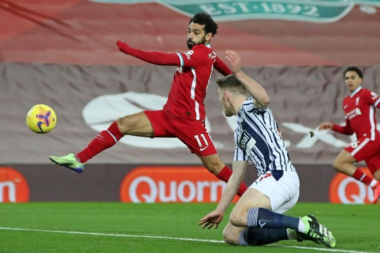 Shooting blanks: Liverpool's surprise 1-1 draw with West Brom tightened the Premier League title race