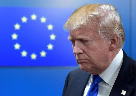 FILE PHOTO - U.S. President Donald Trump reacts as he walks with the President of the European Council Donald Tusk (not pictured) after a meeting in Brussels, Belgium, May 25, 2017.      REUTERS/Eric Vidal