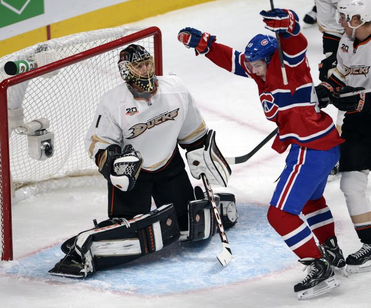 Montreal Canadiens left wing Michael Bournival (49) celebrates after scoring the first goal on Anaheim Ducks goalie Jonas Hiller (1) during first-period NHL hockey game action on Thursday, Oct. 24, 2013. in Montreal. (AP Photo/The Canadian Press, Ryan Remiorz)