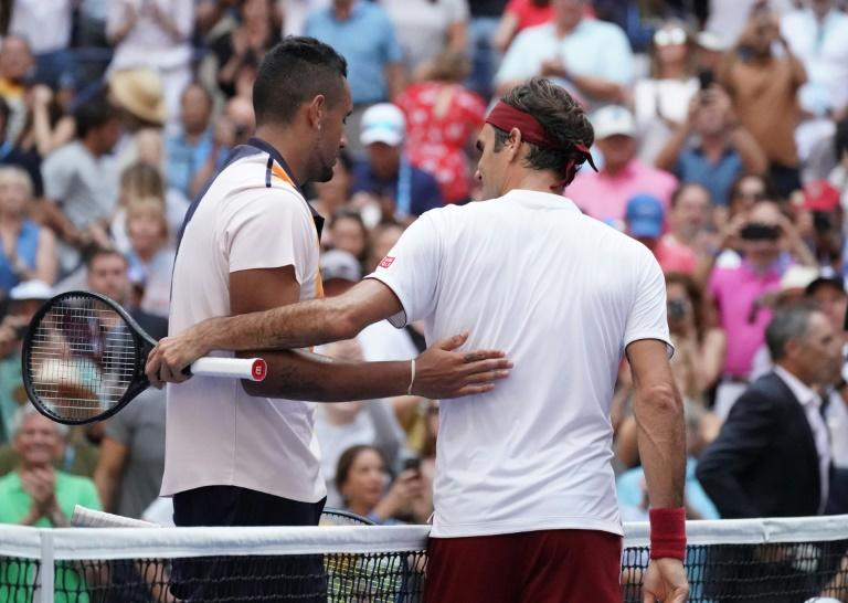 Roger Federer hugs Nick Kyrgios after winning their third round match on Saturday