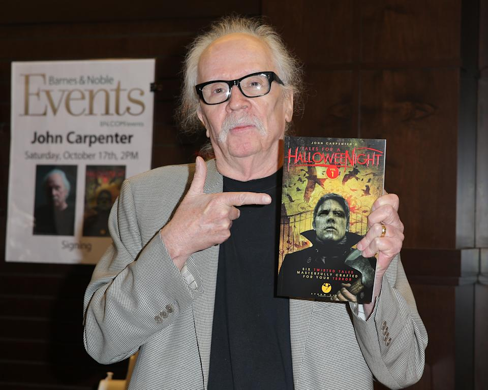 LOS ANGELES, CA - OCTOBER 17:  Director/screenwriter John Carpenter signs copies of his new book, 'John Carpenter's Tale For A Halloween Night' at Barnes & Noble at The Grove on October 17, 2015 in Los Angeles, California.  (Photo by Imeh Akpanudosen/Getty Images)