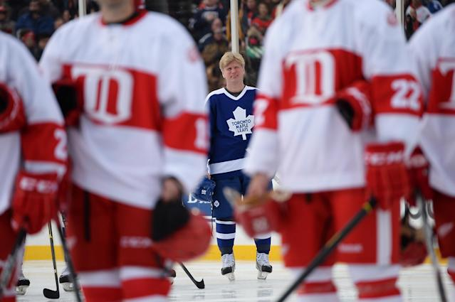 DETROIT, MI - DECEMBER 31: Nikolai Borschevsky #16 of the Toronto Maple Leafs stands on the blueline for the Canadian National Anthem before the game against the Detroit Red Wings during the 2013 Hockeytown Winter Festival Alumni Showdown on December 31, 2013 at Comerica Park in Detroit, Michigan. (Photo by Jamie Sabau/Getty Images)