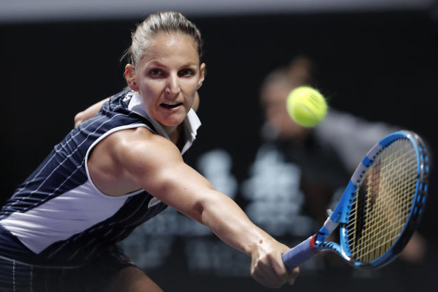 In this Saturday, Nov. 2, 2019 file photo, Karolina Pliskova of the Czech Republic hits a return shot against Ashleigh Barty of Australia during the WTA Finals Tennis Tournament at the Shenzhen Bay Sports Center in Shenzhen, China's Guangdong province. World No. 2 Karolina Pliskova has announced she has hired Daniel Vallverdu as her new coach. (AP Photo/Andy Wong/File)