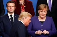 US President Donald Trump (C) has criticized the leaders of several of Washington's traditional allies including French President Emmanuel Macron (L) and German Chancellor Angela Merkel
