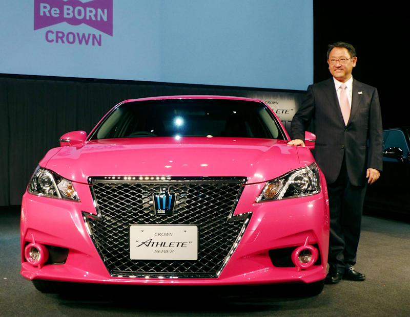 In this Tuesday, Dec. 25, 2012 photo,  Toyota Motor Corp. President Akio Toyoda smiles as he shows a remodeled Crown sedan in Tokyo. Toyota expects to sell a record 9.7 million vehicles this year, bouncing back by 22 percent from a disaster-struck 2011. It has set an even higher target of 9.91 million vehicles for 2013. The numbers released this week underline Toyota's solid turnaround from supply disruptions caused by the earthquake and tsunami in northeastern Japan in 2011 that had hurt global production and sales. (AP Photo/Kyodo News) JAPAN OUT, MANDATORY CREDIT, NO LICENSING IN CHINA, HONG KONG, JAPAN, SOUTH KOREA AND FRANCE
