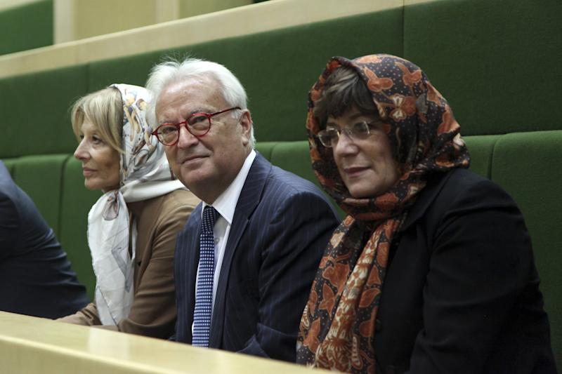 From left to right, Véronique De Keyser from Belgium's Socialist party, Hannes Swoboda of the Austrian social democratic party and Portuguese politician Ana Gomes, all members of European Parliament, attend a general meeting of Iranian parliament in Tehran, Iran, Sunday Oct. 20, 2013. (AP Photo/Ebrahim Noroozi)