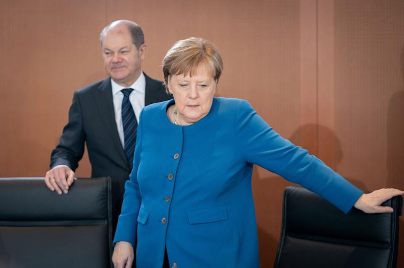 11 March 2020, Berlin: Olaf Scholz (SPD), Federal Minister of Finance, and Chancellor Angela Merkel (CDU) will attend the meeting of the Federal Cabinet. Photo: Kay Nietfeld/dpa (Photo by Kay Nietfeld/picture alliance via Getty Images) (Photo: picture alliance via Getty Images)