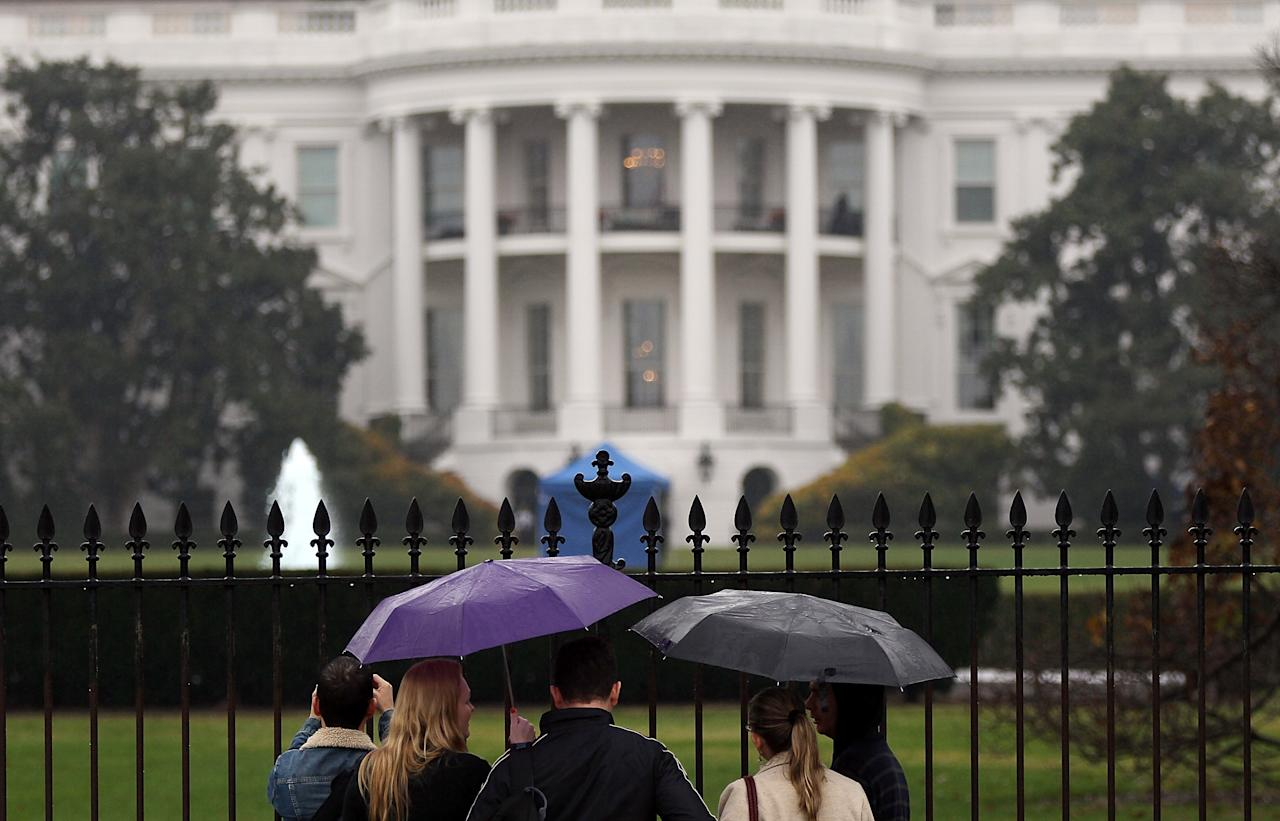 WASHINGTON, DC - NOVEMBER 16:  Tourists stand outside the south side of the White House near where a bullet struck a window of the White House November 16, 2011 in Washington, DC. The bullets are believed to have been fired last Friday after witnesses heard gunshots and saw two vehicles speeding away from the area.  (Photo by Win McNamee/Getty Images)