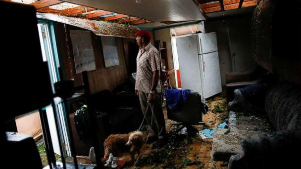 PHOTO: Agapito Lopez looks at the damage in his house after the area was hit by Hurricane Maria in Guayama, Puerto Rico, Sept. 20, 2017. (Carlos Garcia Rawlins/Reuters)