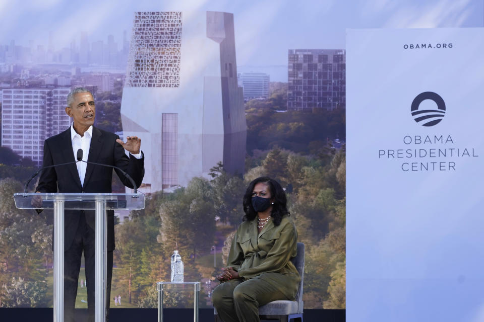 Former President Barack Obama speaks as former first lady Michelle Obama listens during a groundbreaking ceremony for the Obama Presidential Center Tuesday, Sept. 28, 2021, in Chicago. (AP Photo/Charles Rex Arbogast)