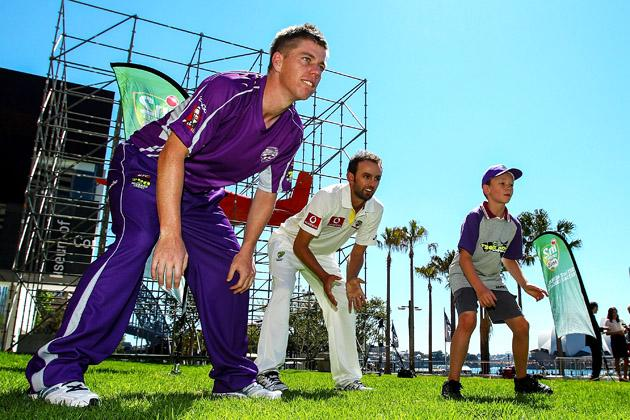 SYDNEY, AUSTRALIA - OCTOBER 15:  Xavier Dohery and Ed Cowan play cricket with children before the Cricket Australia season launch at Museum of Contemporary Art on October 15, 2012 in Sydney, Australia.  (Photo by Mark Nolan/Getty Images)
