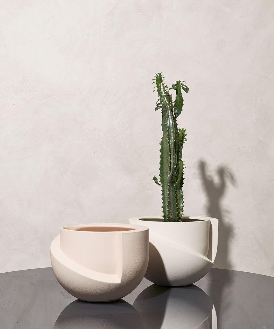 """People tend to gift vases over planters for reasons we can't explain, but Light + Ladder's Vayu planter has all the elements of a perfect gift: looks great from all angles and is entirely functional. $80, Trnk. <a href=""""https://www.trnk-nyc.com/collections/planters-vases/products/vayu-tabletop-planter"""" rel=""""nofollow noopener"""" target=""""_blank"""" data-ylk=""""slk:Get it now!"""" class=""""link rapid-noclick-resp"""">Get it now!</a>"""