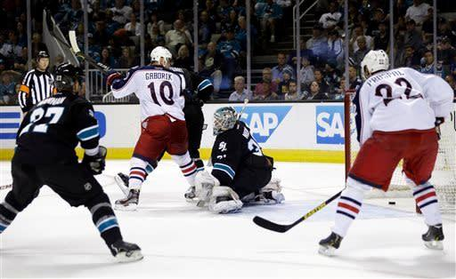 San Jose Sharks goalie Antti Niemi, center, of Finland, is beaten for a goal in front of Columbus Blue Jackets right wing Marian Gaborik (10), of Slovakia, on a shot from Mark Letestu during the second period of an NHL hockey game in San Jose, Calif., Sunday, April 21, 2013. (AP Photo/Marcio Jose Sanchez)