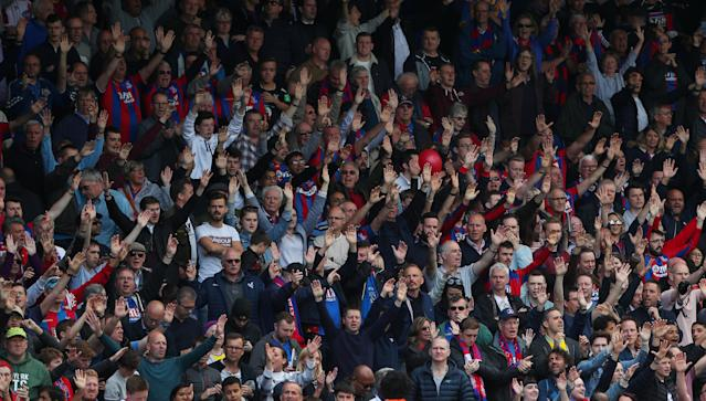 "Soccer Football - Premier League - Crystal Palace vs West Bromwich Albion - Selhurst Park, London, Britain - May 13, 2018 Crystal Palace fans celebrate after the match REUTERS/Hannah McKay EDITORIAL USE ONLY. No use with unauthorized audio, video, data, fixture lists, club/league logos or ""live"" services. Online in-match use limited to 75 images, no video emulation. No use in betting, games or single club/league/player publications. Please contact your account representative for further details."
