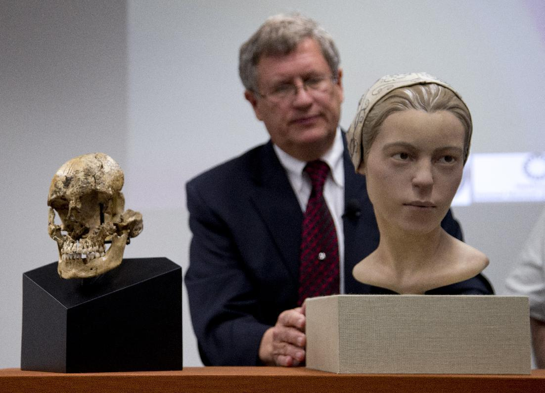 "Doug Owsley, division head for Physical Anthropology at the Smithsonian's National Museum of Natural History, displays the skull and facial reconstruction of ""Jane of Jamestown"" during a news conference at the museum in Washington, Wednesday, May 1, 2013. Scientists announced during the news conference that they have found the first solid archaeological evidence that some of the earliest American colonists at Jamestown, Va., survived harsh conditions by turning to cannibalism presenting the discovery of the bones of a 14-year-old girl, ""Jane"" that show clear signs that she was cannibalized. (AP Photo/Carolyn Kaster)"