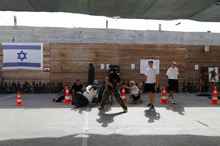"<p>A group of tourists takes part in a two hour ""boot camp"" experience, at ""Caliber 3 Israeli Counter Terror and Security Academy"" in the Gush Etzion settlement bloc south of Jerusalem in the occupied West Bank July 13, 2017. (Photo: Nir Elias/Reuters) </p>"