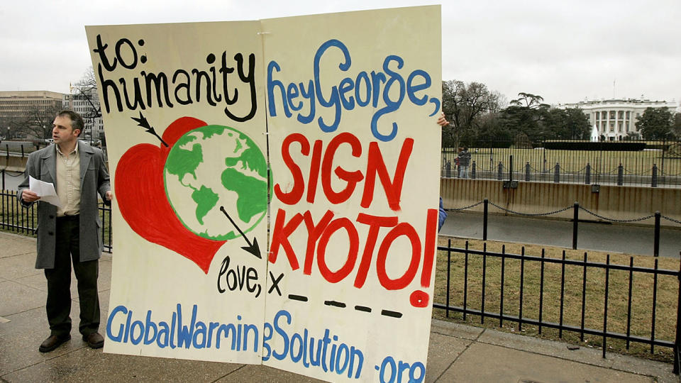 David Merrill Executive Director of the National Global Warming Coalition reads from a paper urging U.S. President George W. Bush to sign the Kyoto Protocol during a protest on the Ellipse behind the White House February 14, 2005 in Washington, DC. (Mark Wilson/Getty Images)