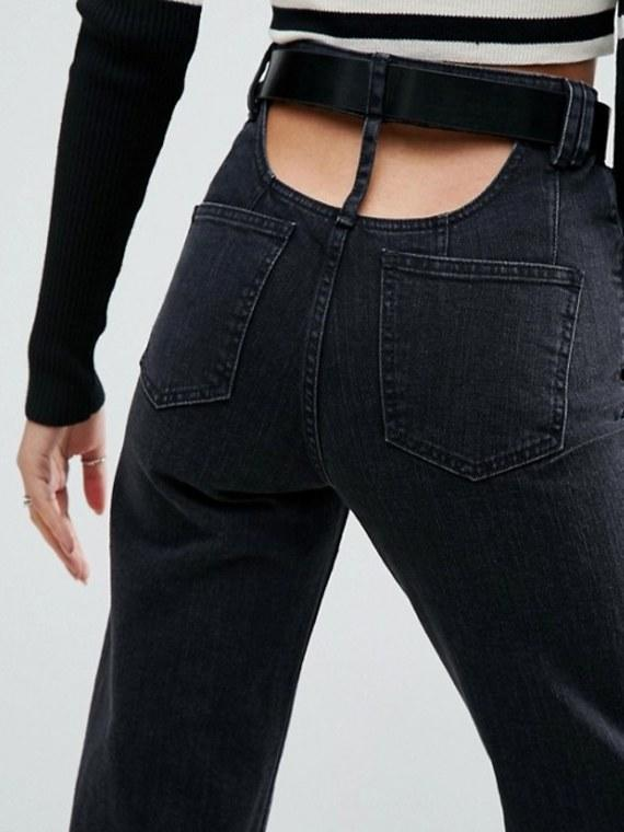 "<p>ASOS is selling these ""<span><a rel=""nofollow"" href=""http://www.asos.com/asos/asos-high-waisted-straight-leg-jeans-with-open-back-in-ashes-washed-black-with-belt/prd/8396739"">high waisted straight leg jeans with open back</a>"" that feature cutouts just above your butt, giving you the illusion of a permanent plumber's crack. </span><em>(Photo: ASOS)</em> </p>"
